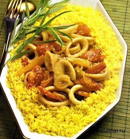 Готовое блюдо Кальмары, тушенные с перцем и кунжутом